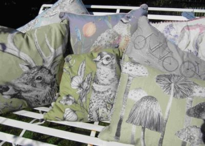 Contemporary designs of cushions with wildlife images in nature linen material.